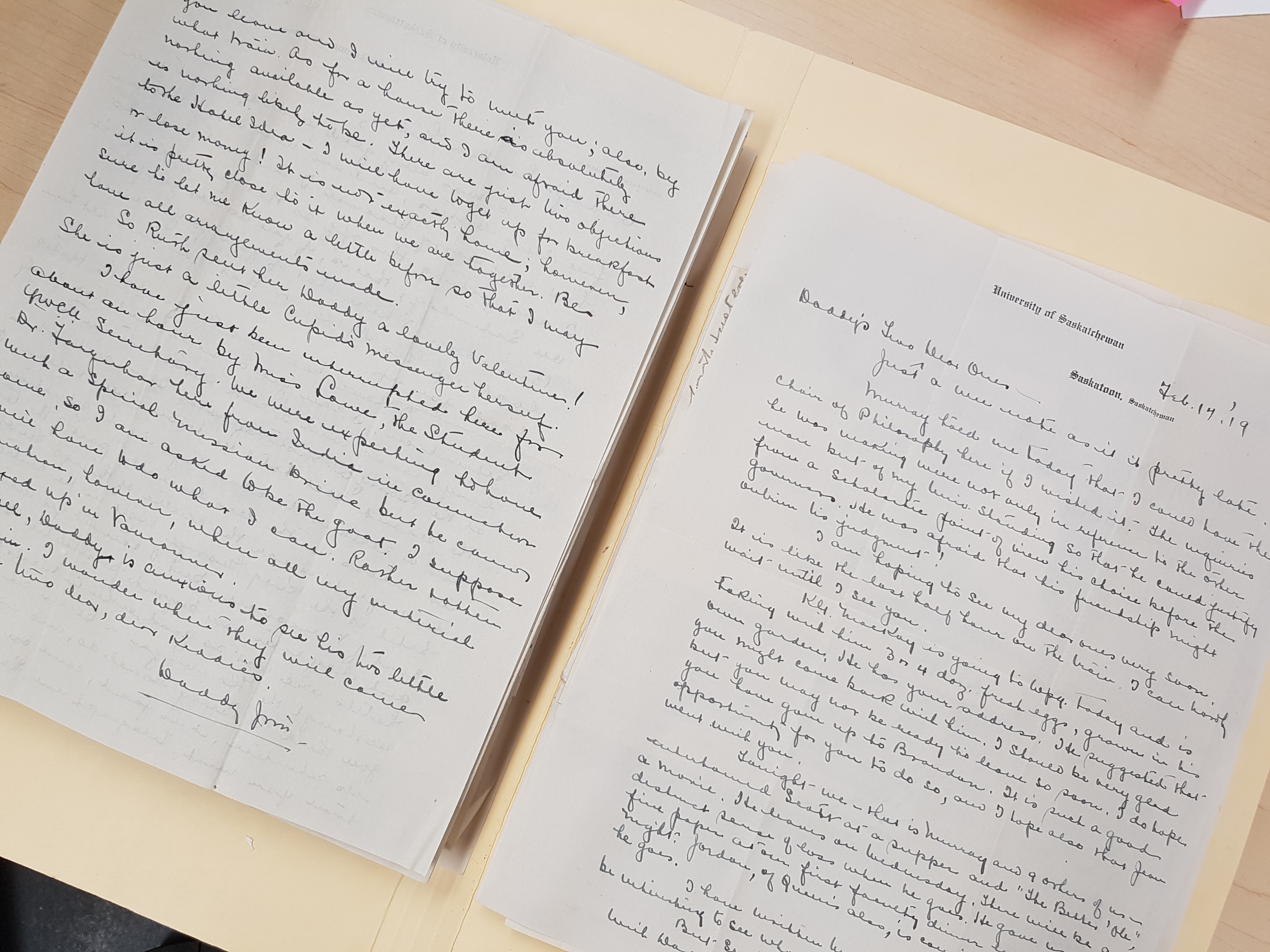 Photograph of handwritten documents inside a manila folder.