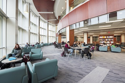 Students studying on the ground floor of the Leslie and Irene Dube Health Science Library.