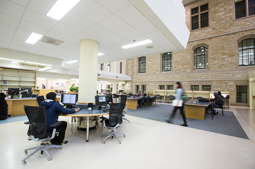 Students at computers and desks inside the Science Library, ground floor.